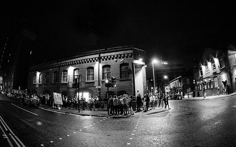 People queuing outside The Factory Club in Manchester