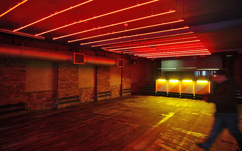 The interiors of Factory Club, Manchester, with exposed brickwork and neon strip lighting