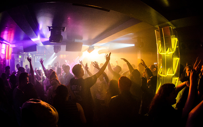 People partying with their hands in the air, in The Factory nightclub in Manchester