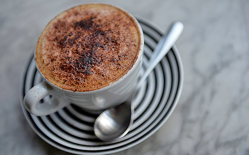 A coffee with chocolate on top