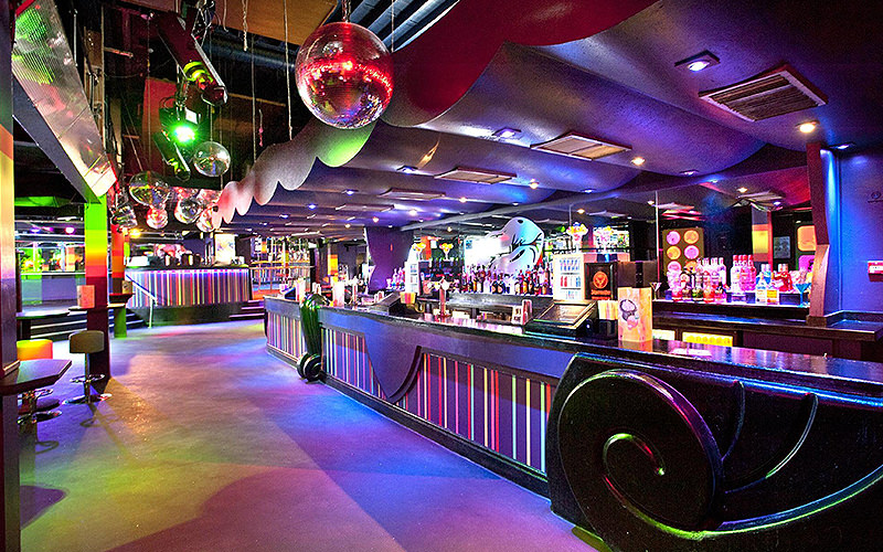 Disco balls above the purple bar at Pop World, Liverpool