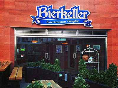 The exterior of Bierkeller in Liverpools, with seating and plants in the foreground