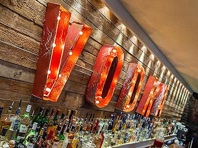 Lit up vodka sign above the bar at Revolution