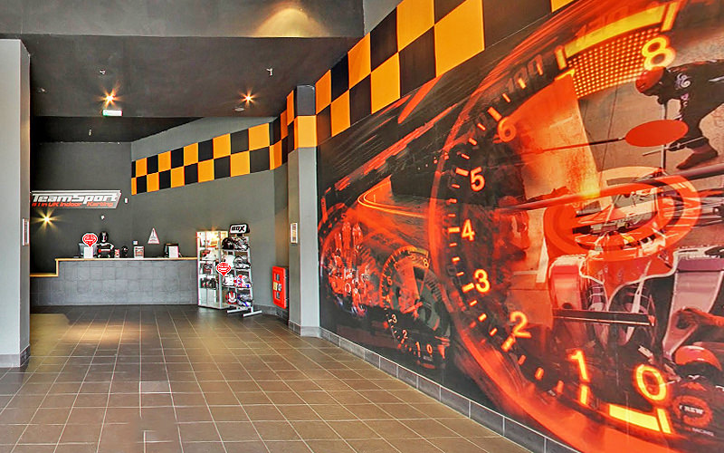 A reception, with a speedometer and go karts painted on the wall