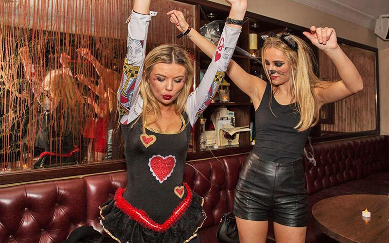Two women dancing in Beaufort House, London