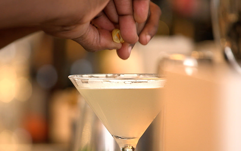 Close up of a man's hand, creating a cocktail