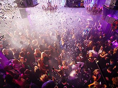 Confetti falling down on a busy nightclub dance floor
