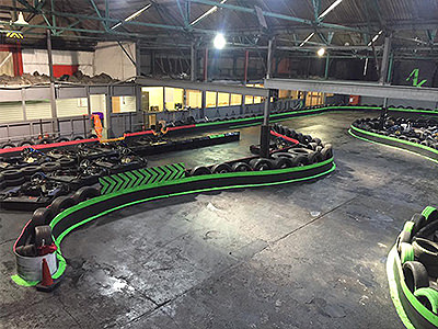 Indoor go karting track, with tyres lining the edge of the track
