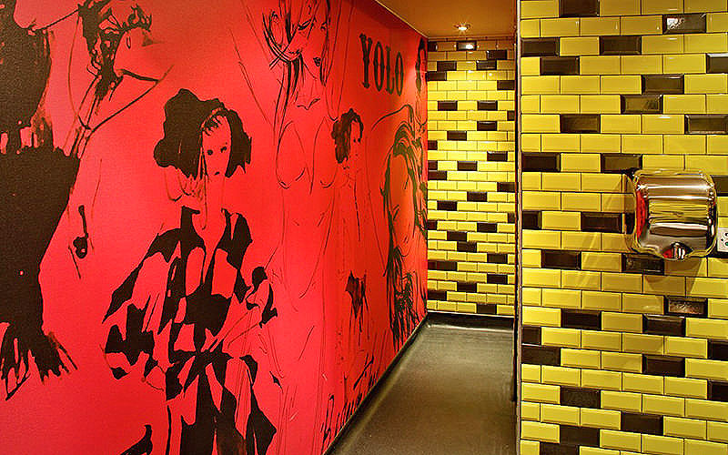 The toilets, with murals and yellow bricks, at Bar Soho